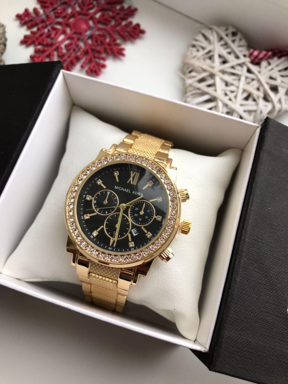 Женские наручные часы Michael Kors золотого цвета