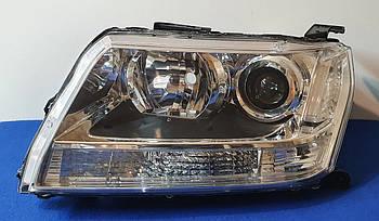 Оригинальная передняя левая фара Suzuki Grand Vitara XENON 2006 - 2012