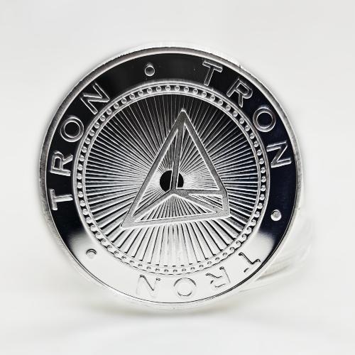 Сувенірна Монета TRON (TRN) срібного кольору.