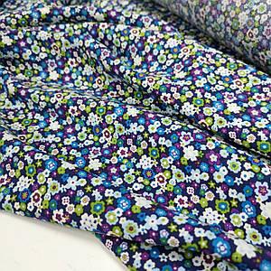 Ткань штапель мелкие цветочки на синем