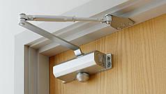 Доводчики дверей – як вони працюють?