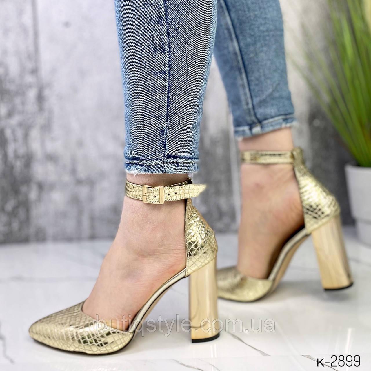Жіночі золотисті туфлі натуральна шкіра з тисненням