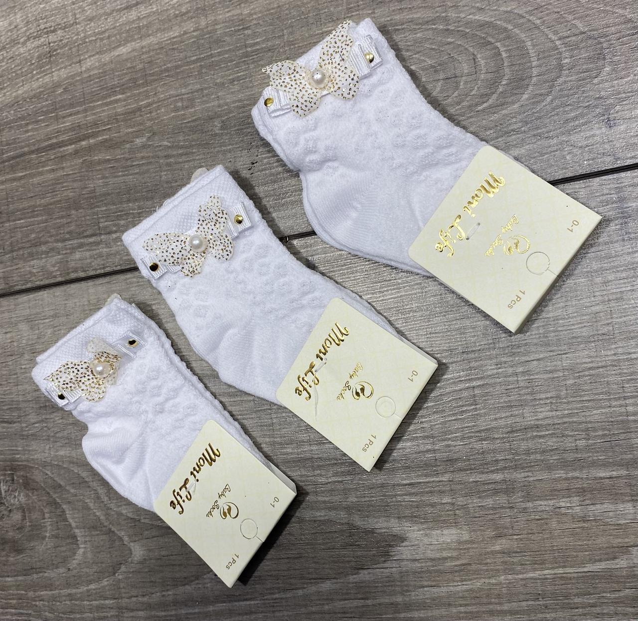 Дитячі шкарпетки середні Moni life білі з бантиками і намистинками бавовна для дівчаток 0, 1, 3 роки 12 шт в уп