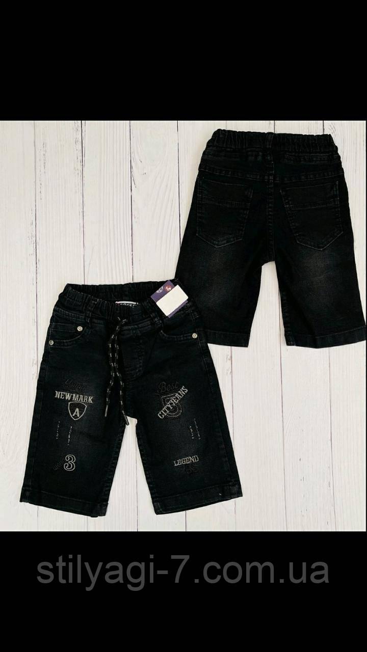 Джинсовые бриджи для мальчика 8-12 лет черного цвета на резинке с карманами оптом