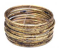 Комплект из 12 браслетов кольцо Дутые желтый метал d = 7 см.