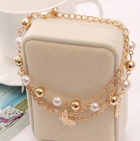 Стильний жіночий браслет Метелики з перлами код 1267