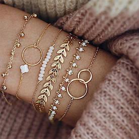 Набір жіночих золотих браслетів на руку код 2070