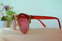 Солнцезащитные красные очки в золотой оправе