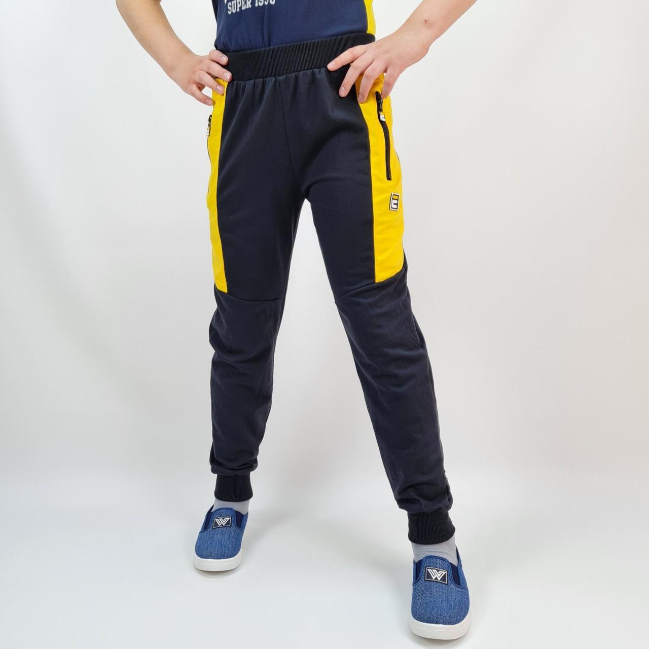 Спортивні штани для хлопчика чорні з жовтим тм Mr.David розмір 140,152,158,164 см