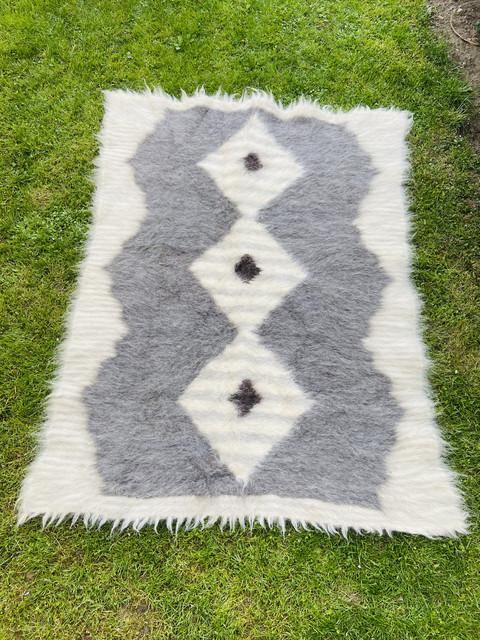 Ковдри та подушки з овечої шерсті