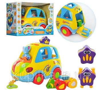 Развивающая игрушка машинка-сортер Автошка 9198 толокар с звуковыми и световыми эффектами