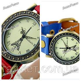 """Женские наручные часы """"Эйфелева башня"""" с заклепками и ремешком синего или красного цвета."""