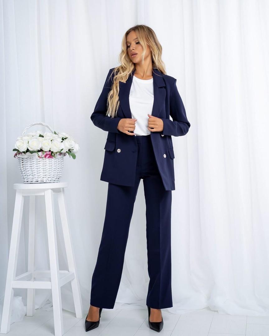 Жіночий синій брючний костюм, 44