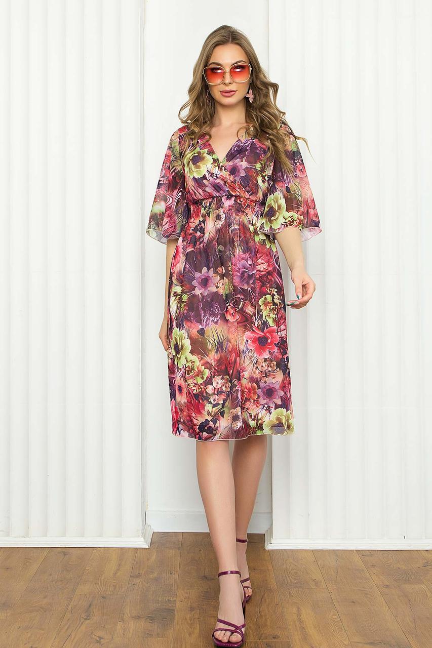 Легке шифонове плаття міді з помилковим запахом і рукавом-крильце. Квітковий принт