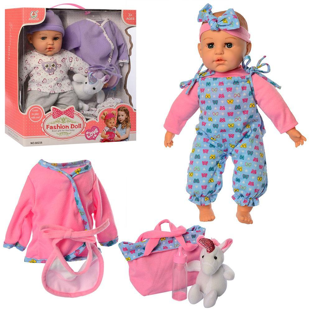 Функціональний, м'яконабивний пупс з додатковим нарядом, пляшкою і сумкою для дівчинки 60235 (2 види)