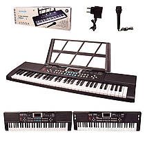 Дитячий синтезатор (орган, фортепіано) на 61 клавіш, мікрофон, USB зарядний пристрій.