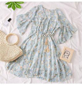 Женское платье в голубом цвете