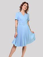 Трендові жіночу сукню виконано з тканини стрейч креп блакитного кольору в розмірах 48-54