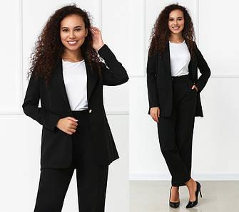 Женский костюм классический с широкими брюками и пиджаком