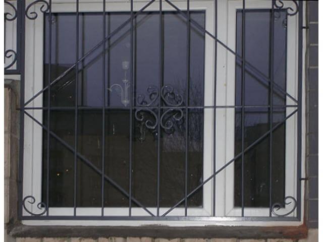 Кованные оконные решетки