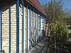 Утепление и отделка фасада частного дома сайдингом.