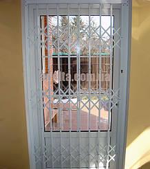 Защитные раздвижные решетки на двери для дома