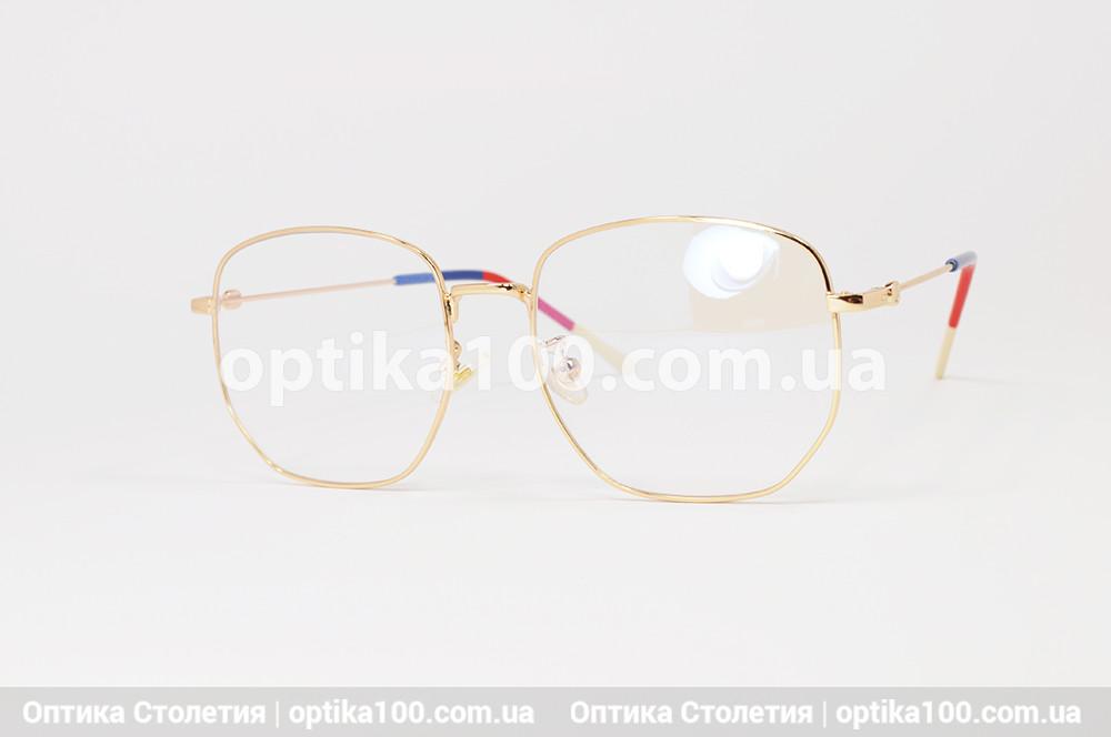 Велика жіноча золотиста оправа окулярів. Металева