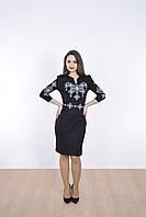 Оригинальное платье в черном цвете украшено вышитым орнаментом
