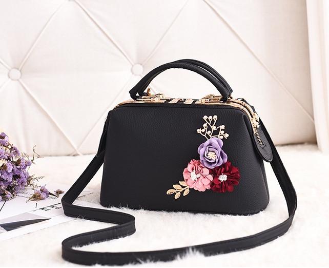 Стильна жіноча сумка з квітами