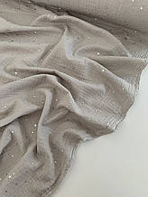 Муслін (бавовняна тканина) жатка Гліттер срібна зірочка на світло-сірому (ширина 1,35 м)