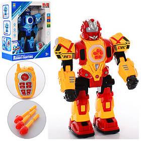 Робот (33,5 см.) дист. керув., муз., світло, стріли, танцює, бат., кор,