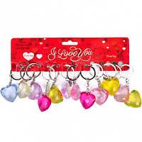 От 24 шт. Брелок пластиковый 2-110 сердце прозрачное разноцветное купить оптом в интернет магазине От 24 шт.