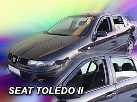 Дефлекторы окон (ветровики) Seat Toledo II/Leon 4/5D 1999-2005 (+OT) (вставные, кт - 4 шт)