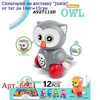 Заводна іграшка 6621 сова,  8, 3см,  їздить,  подв, деталі,  12шт (6 кольорів) в дисплеї,  21-32-9см