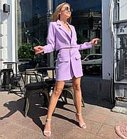 Женский костюм с юбкой и укороченным пиджаком свободного кроя