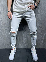 Мужские зауженные джинсы (белые) рваные в области колена S6129