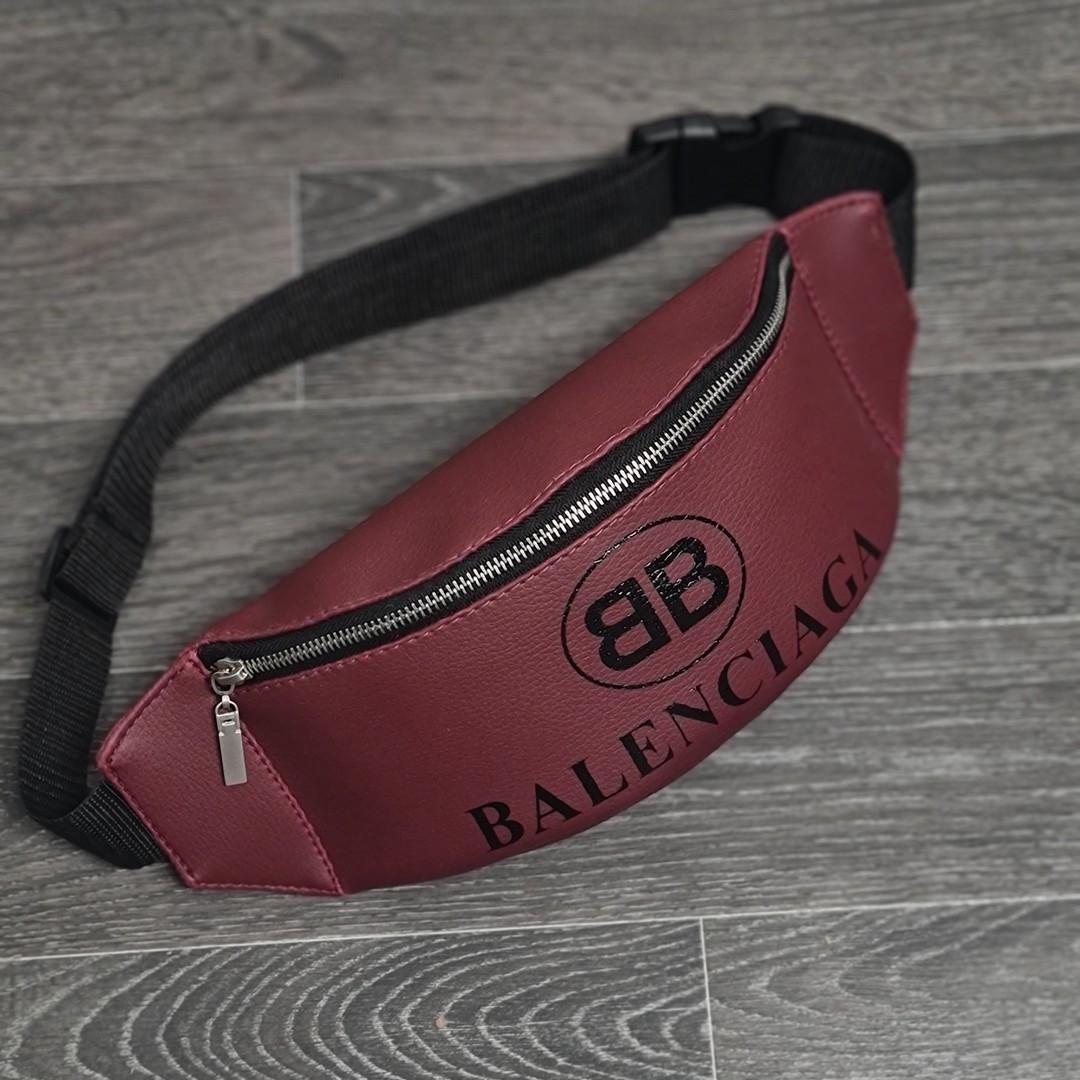 Стильная кожаная бордовая поясная сумка, бананка Balenciaga.