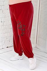 Червоні штани для повних дівчат модні шаровари