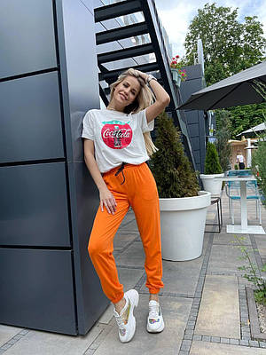 Яркие оранжевые летние спортивные штаны женские