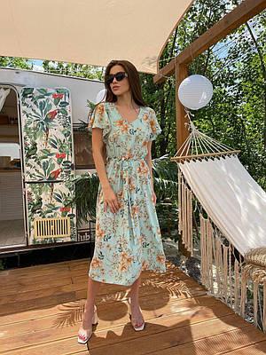 Літній бірюзове плаття з квітковим принтом нижче коліна