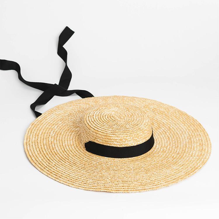 Бежева солом'яний капелюх з чорним обідком на зав'язках Beiger