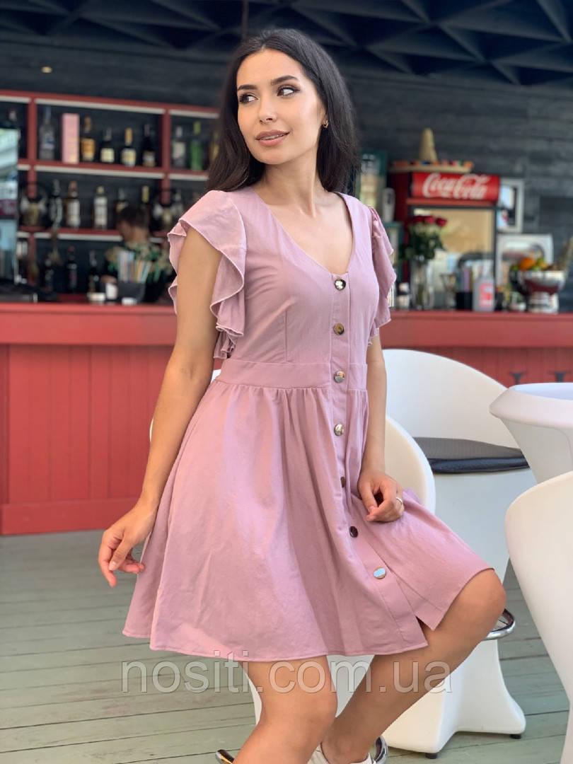 Жіноча сукня вільного крою на кнопках