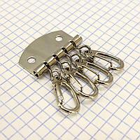 Ключница на 4 ключа никель t5009 (10 шт.)