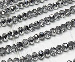 Бусины хрустальные (Рондель) 6х4мм пачка - 95-105 шт, цвет - прозрачный с серебряным бочком