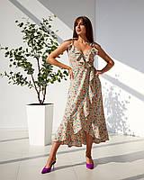 Сарафан с расширенной юбкой и приталенным верхом, красивым декольте и воланами