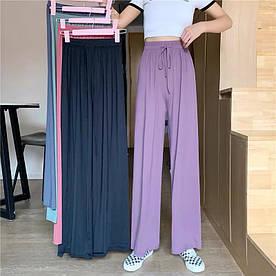 Жіночі розкльошені штани трикотаж 42-50 (в кольорах)