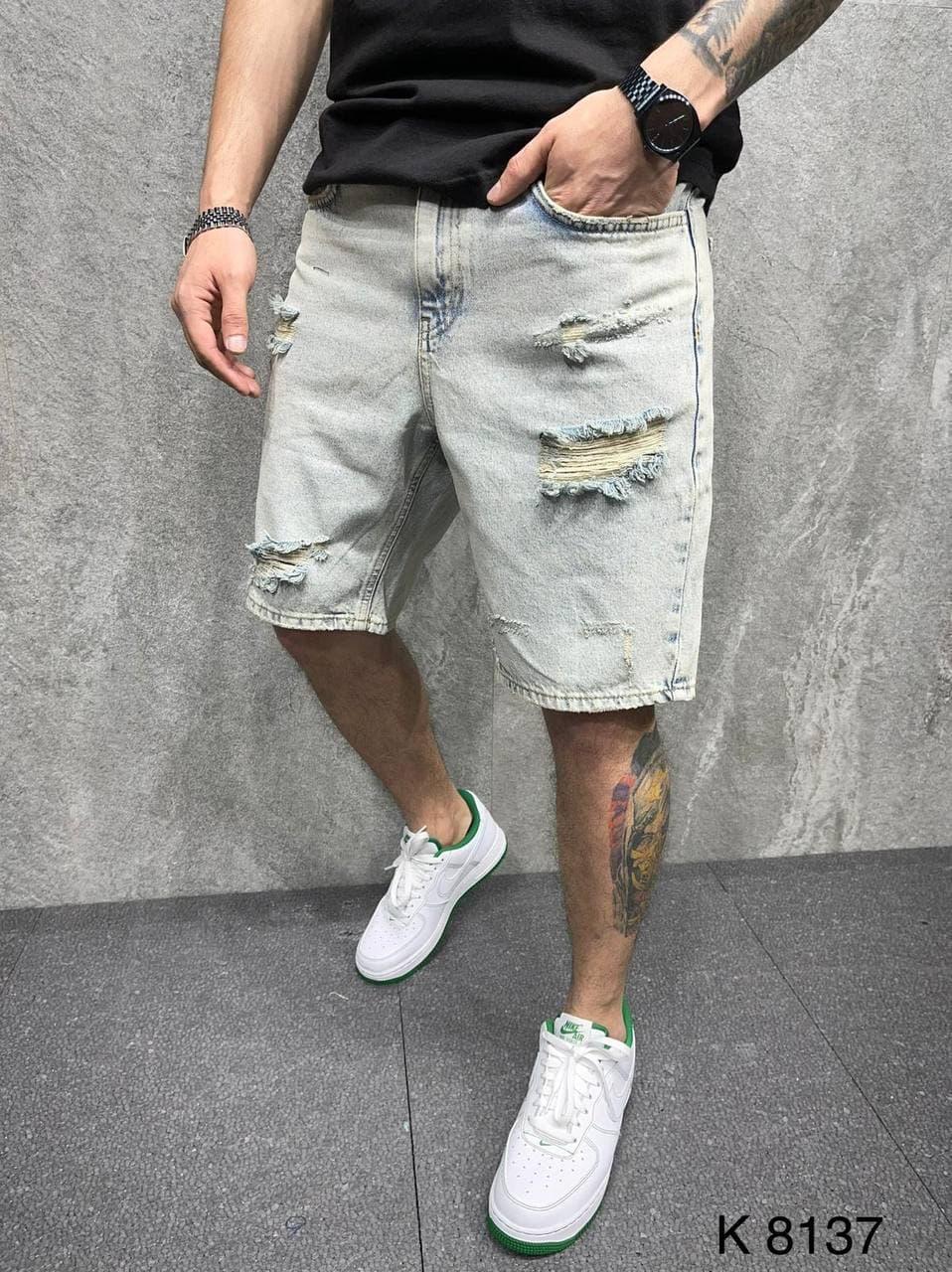 Чоловічі джинсові шорти блакитного кольору рвані