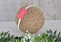 Пов'язка з плетеним малиновим бантиком