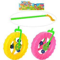 Каталка 1289  на палке 38см, колесо 24см, трещотка, 2 цвета, в кульке, 25,5-34-7см
