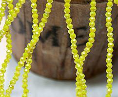 Бусины хрустальные 2х2мм кол-во: 180-190 шт, непрозрачный лимонный с АБ